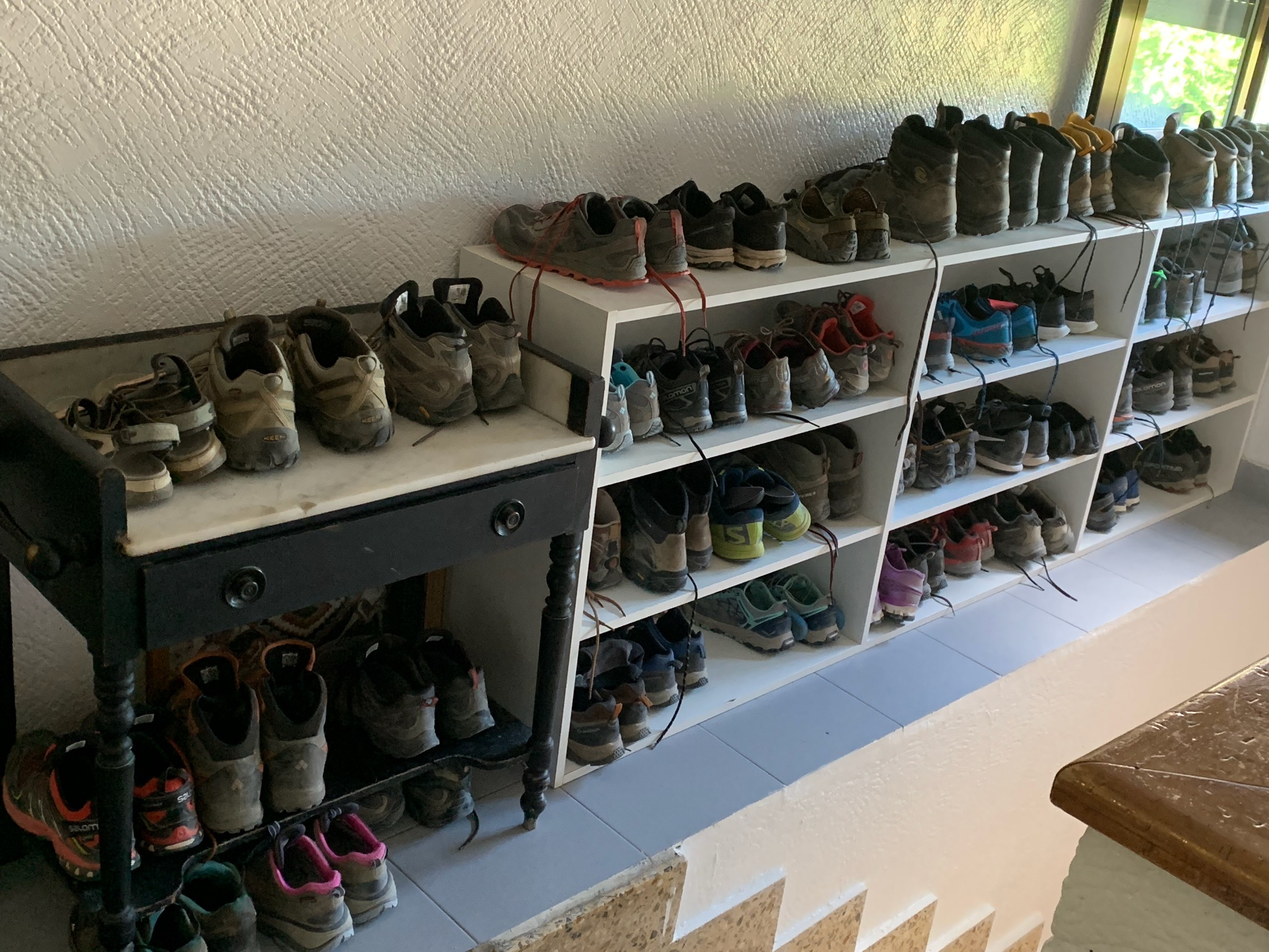 These are the shoes of all the pilgrims at a hostel/albergue